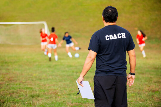 Man coaching girls soccer team