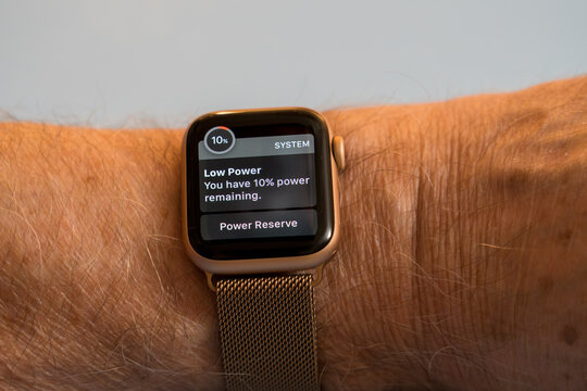 Morgantown, WV - 3 December 2020: Apple watch series six showing system alert about low power warning due to short battery life