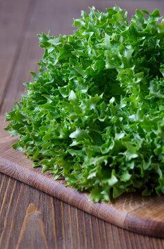 Bunch of green lettuce on wooden board
