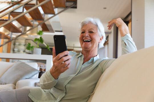 Happy senior caucasian woman having video call using smartphone