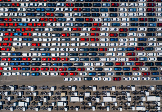 Aerial top down photo of new cars and trucks at a shipping port in Australia