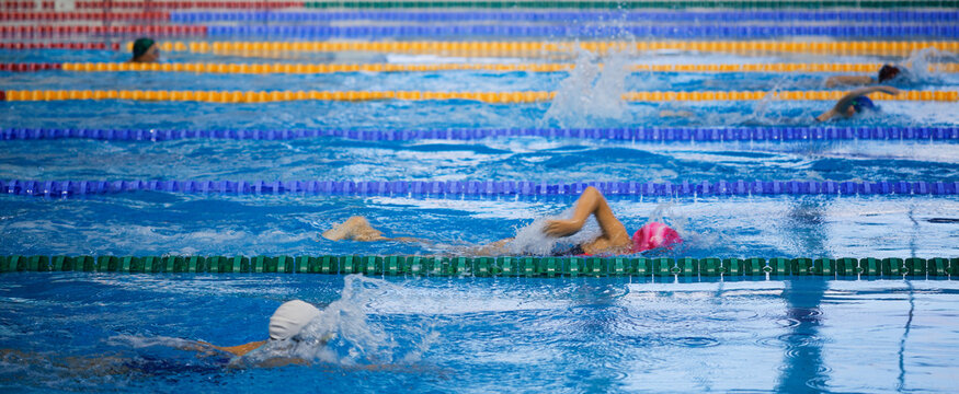 children athletes swim in the pool workout