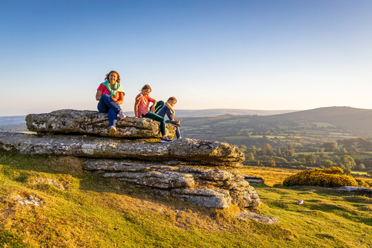 Family in Dartmoor national park in the evening