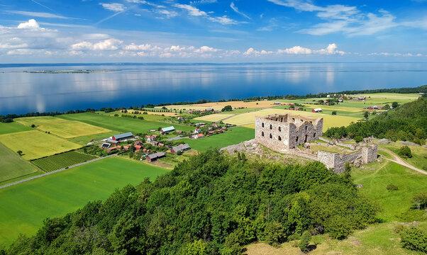 Brahehus Castle with lake panorama - aerial summer view