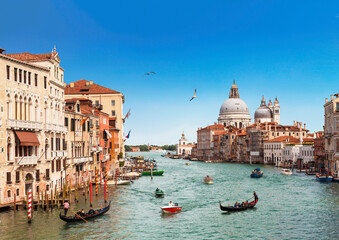 Venice, the Grand canal, the Cathedral of Santa Maria della Salute and gondolas with tourists