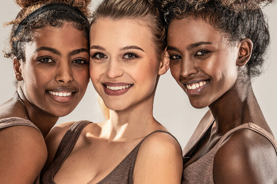 Multi ethnic group of happy and beautiful female friends, studio shot.