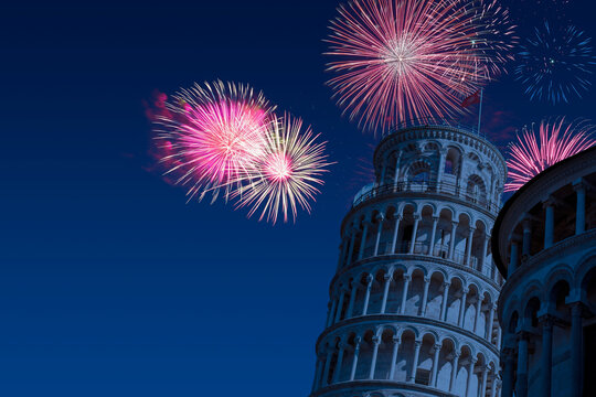 Celebratory fireworks for new year over pisa tower during last night of year. Christmas atmosphere
