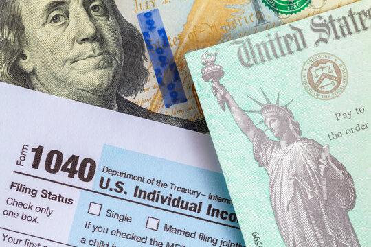 Form 1040 with Tax Check and Money