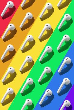 white wireless earphones lying on rainbow lines