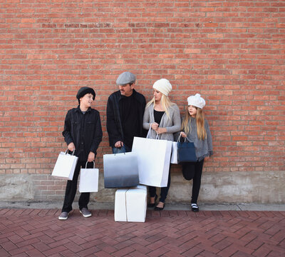 Family Shopping Together with Bags