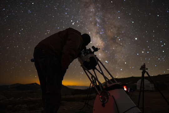 Amateur Astronomer Observing the Stars with a Telescope