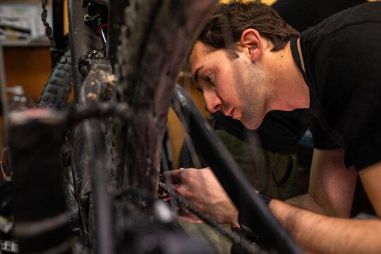 Mechanic repairing bicycle wheel