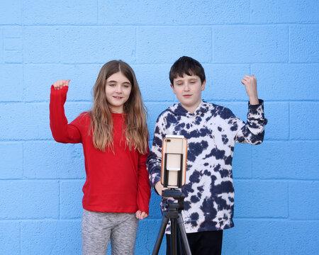 Tween Kids Dancing in Front of Phone Camera