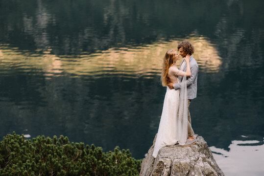 portrait of wedding couple on the background on smooth water surface