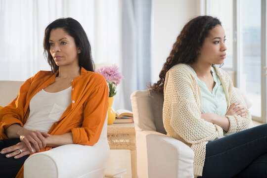 Mother and daughter arguing in living room