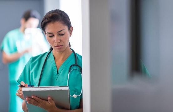 Hispanic nurse working in hospital