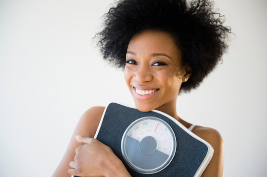 African American woman holding scale