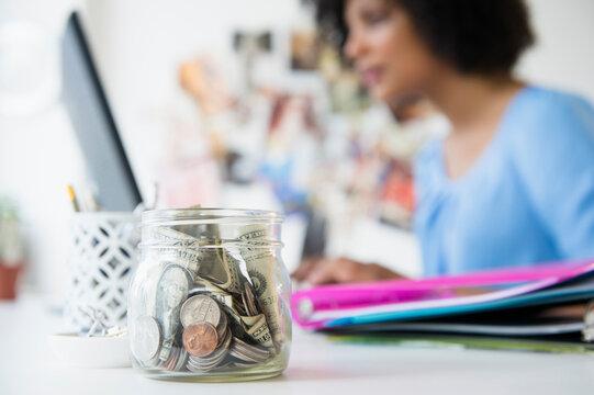 Close up of change jar on desk
