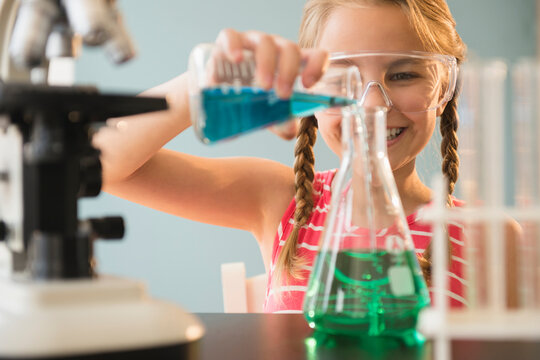Caucasian girl doing science experiment in lab