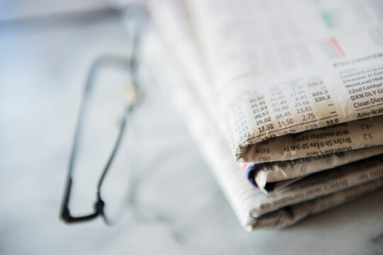 Close up of business newspaper with stocks