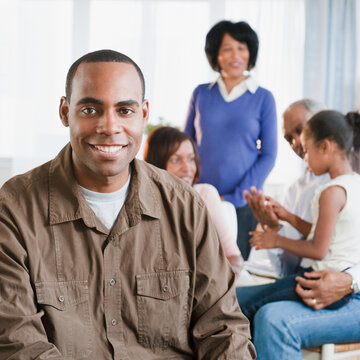 African American man in living room with family