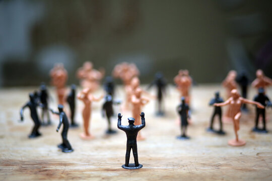 close up picture of toys depicting social unrest