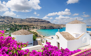 Wall Mural - Landscape with beach and white church in Lindos, Rhodes, Greece