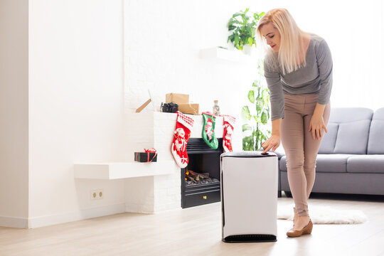 Coronavirus panic, Air purifier in a living room, Humidification air in apartment during period self-isolation due coronavirus pandemic