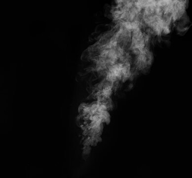 Smoke fragments on a black background. Abstract background, design element, for overlay on pictures