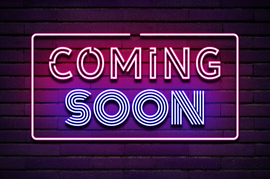 Coming soon glowing purple violet neon text on brick wall