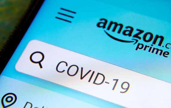 Amazon Prime app search with COVID-19 word typed in it on the smartphone sreen. Photo with selective focus. Concept. Stone / United Kingdom - April 4 2020.