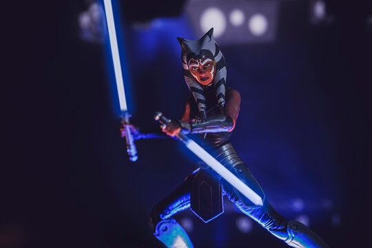 NEW YORK USA - DEC 5 2020: Scene from Star Wars The Clone Wars with former Jedi Ahsoka Tano and lightsabers - Hasbro action figure