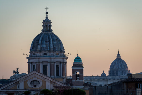 The Dome of Basilica of SS. Ambrose and Charles on the Corso and The Dome of St. Peter's Basilica