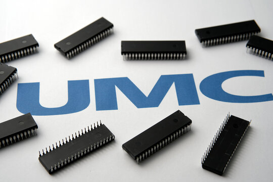 United Microelectronics Corporation. Semiconductors chips and blurred UMC logo. Stafford / United Kingdom - October 22, 2020: