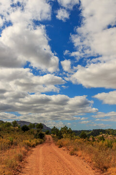 Mountain dirt road with big clouds.Nature elements concept