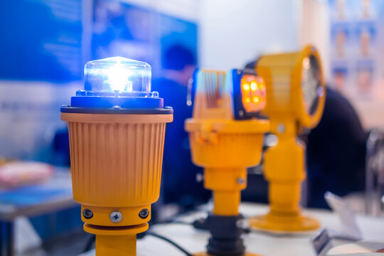 Close up of alarm lamp signal warning flashing lights for industrial machinery at emergency, support and services exhibition. Danger, legal, alert light, attention, hazard, manufacturing concept