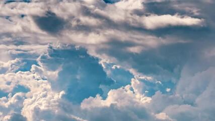 Fotobehang - Clouds in blue storm sky. Timelapse, 4K UHD.