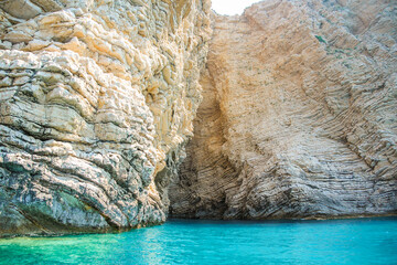 Wall Mural - Landscape with rocks formations and clear water near Paradise beach of Corfu island, Greece
