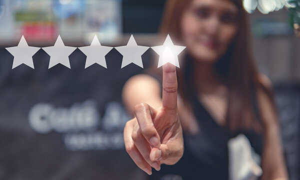 Customer review good rating concept  hand pressing five star on visual screen and positive customer feedback  testimonial
