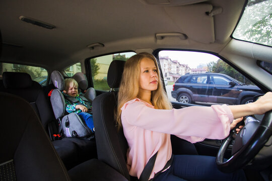 Female nanny drive the car and deliver toddler boy