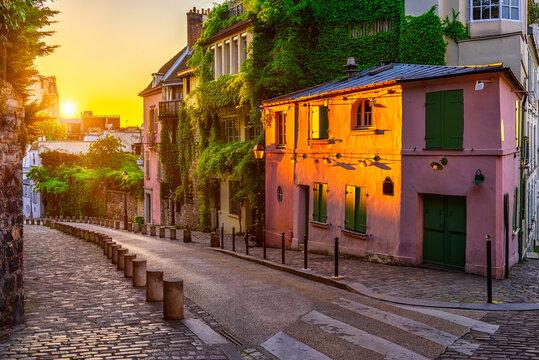 Sunset view of cozy strert in quarter Montmartre in Paris, France