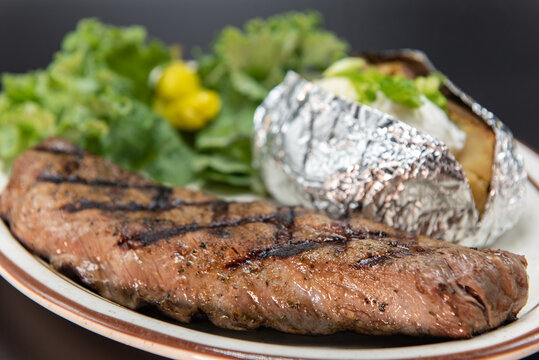 Fresh off the grill tritip steak served with all the familiar baked potato and vegetable sides.