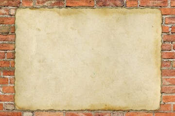 old sheet of paper on old red brick wall
