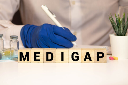 Word Medigap made with wood building blocks