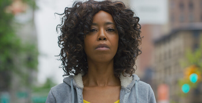 Black African American woman in city serious face portrait