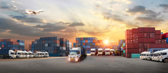 Fototapeta Container truck in ship port for business Logistics and transportation of Container Cargo ship and Cargo plane with working crane bridge in shipyard at sunrise, logistic import export and transport