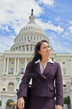 Beautiful mid adult Asian American woman in front of the U.S. Capitol building in Washington, DC