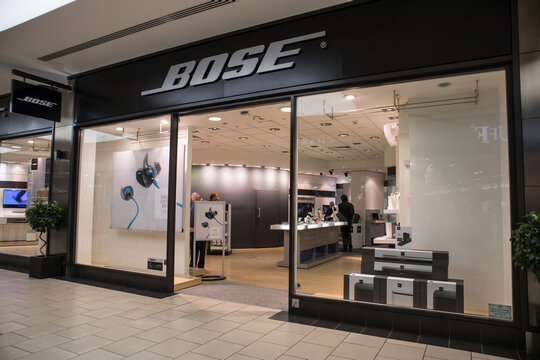 Entrance to Bose audio technology shop store showing window display, sign, signage, logo and branding.