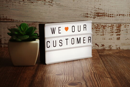 We love our customer word in light box business concept background