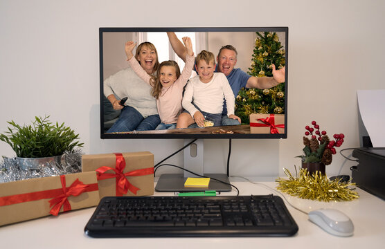People on video call with family celebrating virtual christmas holidays together online
